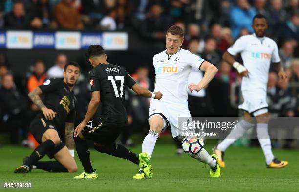 Alfie Mawson of Swansea City and Ayoze Perez of Newcastle United during the Premier League match between Swansea City and Newcastle United at Liberty...