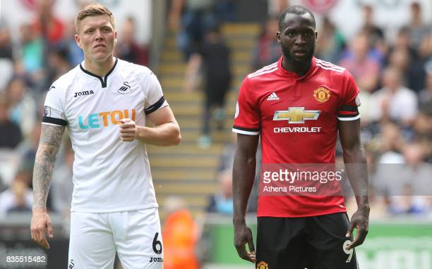 Alfie Mawson of Swansea City and Romelu Lukaku of Manchester United during the Premier League match between Swansea City and Manchester United at The...