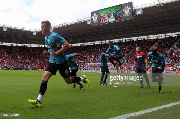 Alfie Mawson of Swansea City and team mates warm up prior to the Premier League match between Southampton and Swansea City at the St Mary's Stadium...