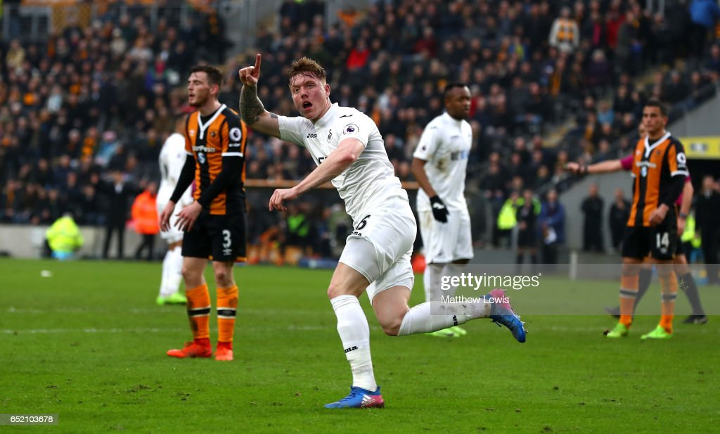 Alfie Mawson of Swansea City celebrates as he scores their first goal during the Premier League match between Hull City and Swansea City at KCOM Stadium on March 11, 2017 in Hull, England.