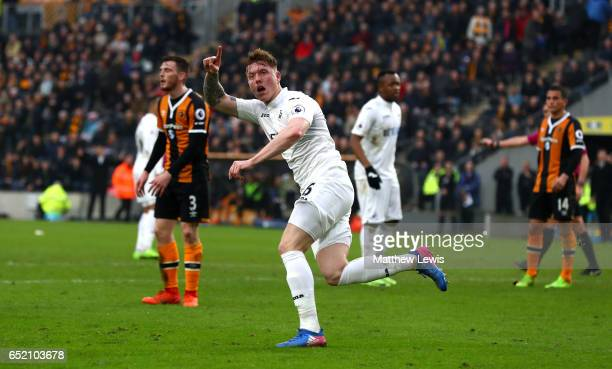 Alfie Mawson of Swansea City celebrates as he scores their first goal during the Premier League match between Hull City and Swansea City at KCOM...