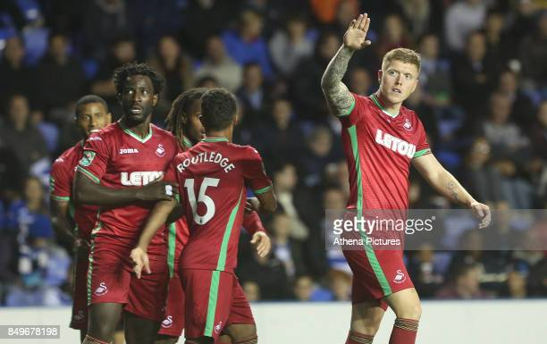 Alfie Mawson of Swansea City celebrates scoring his sides first goal of the match during the Carabao Cup Third Round match between Reading and...