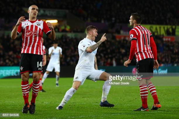 Alfie Mawson of Swansea City celebrates scoring the opening goal during the Premier League match between Swansea City and Southampton at Liberty...