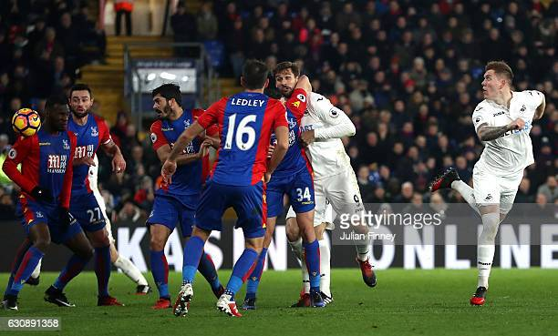 Alfie Mawson of Swansea City heads to score the opening goal during the Premier League match between Crystal Palace and Swansea City at Selhurst Park...