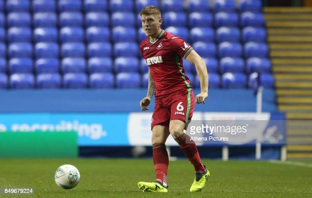 Alfie Mawson of Swansea City in action during the Carabao Cup Third Round match between Reading and Swansea City at Madejski Stadium on September 19...