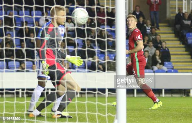 Alfie Mawson of Swansea City scores his sides first goal of the match during the Carabao Cup Third Round match between Reading and Swansea City at...