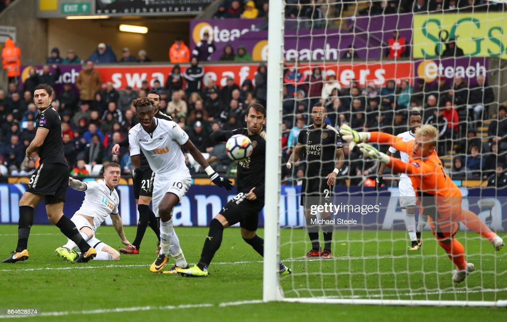 Alfie Mawson of Swansea City scores the 1st Swansea goal during the Premier League match between Swansea City and Leicester City at Liberty Stadium on October 21, 2017 in Swansea, Wales.