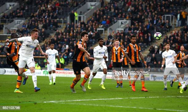 Alfie Mawson of Swansea City scores their first goal during the Premier League match between Hull City and Swansea City at KCOM Stadium on March 11...