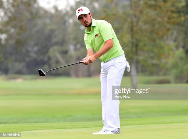 Alfie Plant of Team Great Britain and Ireland reacts to his putt on the second green losing eight and seven to Norman Xiong and Collin Morikawa of...