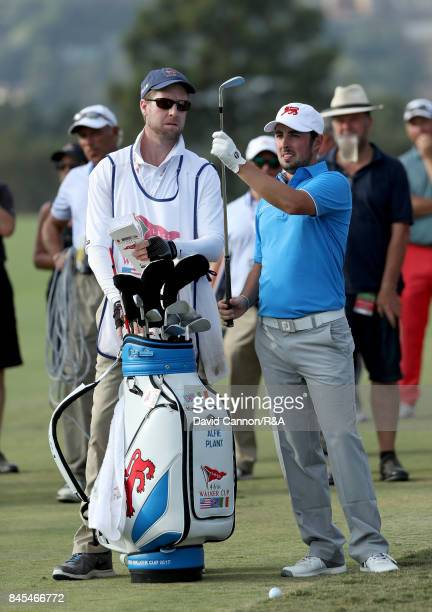 Alfie Plant of the Great Britain and Ireland pulls his club for his third shot on the 14th hole in his match against Maverick McNealy of the United...
