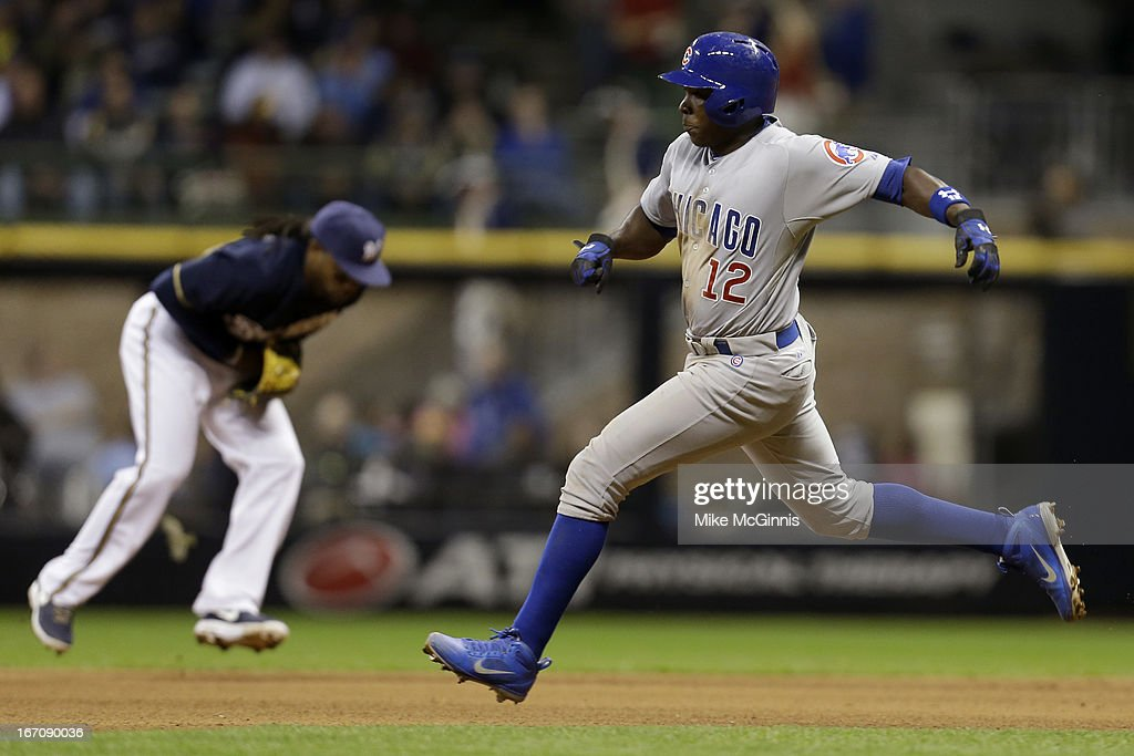 Alfonaso Soriano #12 of the Chicago Cubs jumps over this ball hit by Nate Schierholtz while <a gi-track='captionPersonalityLinkClicked' href=/galleries/search?phrase=Rickie+Weeks&family=editorial&specificpeople=550245 ng-click='$event.stopPropagation()'>Rickie Weeks</a> #23 of the Milwaukee Brewersfields the ball during the top of the sixth inning at Miller Park on April 19, 2013 in Milwaukee, Wisconsin.