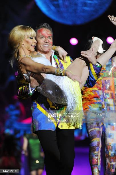 Alfons Haider and Dolly Buster perform during the fashion show at the Life Ball 2012 AIDS charity fundraiser at City Hall on May 19 2012 in Vienna...