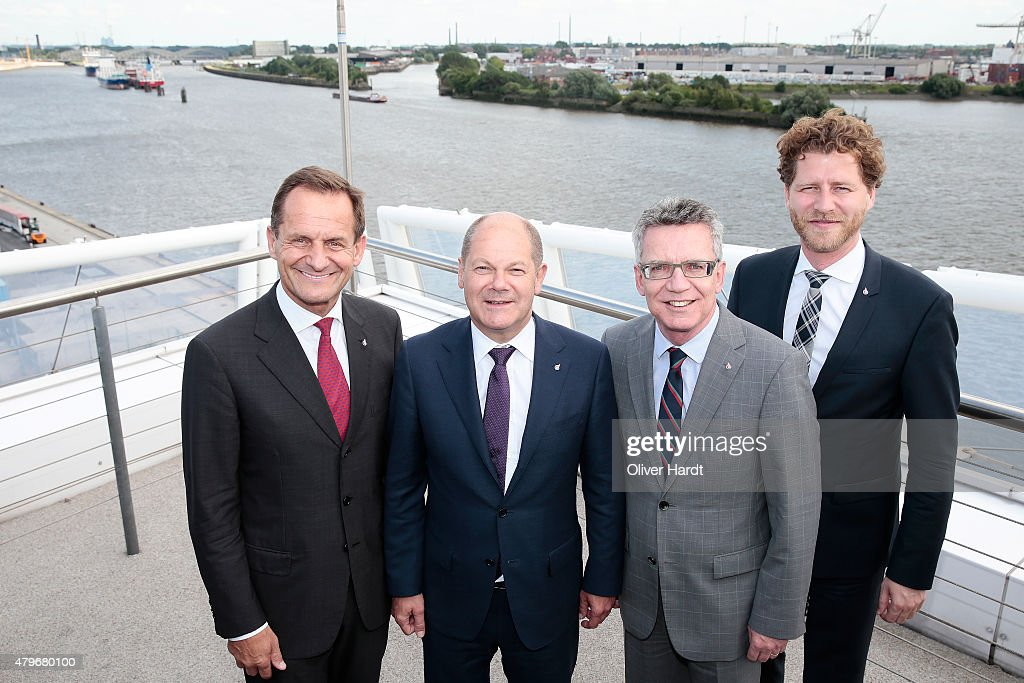 Alfons Hoermann President of DOSB, First mayor of Hamburg Olaf Scholz ,Thomas de Maiziere and CEO of the Olympia Hamburg 2024 Nikolas Hill (L-R) poses before the press conference Hamburg Launches Olympia 2024 Bid Process on July 6, 2015 in Hamburg, Germany.