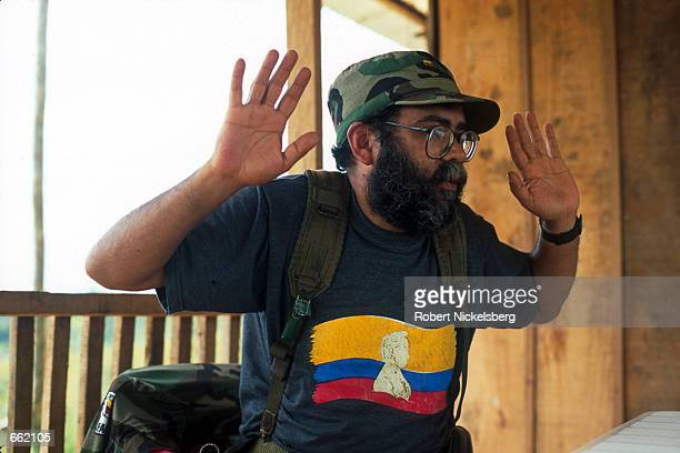 Alfonso Cano a former anthropology professor and now number three in the FARC rebel command speaks with a reporter at the FARC headquarters August 25...