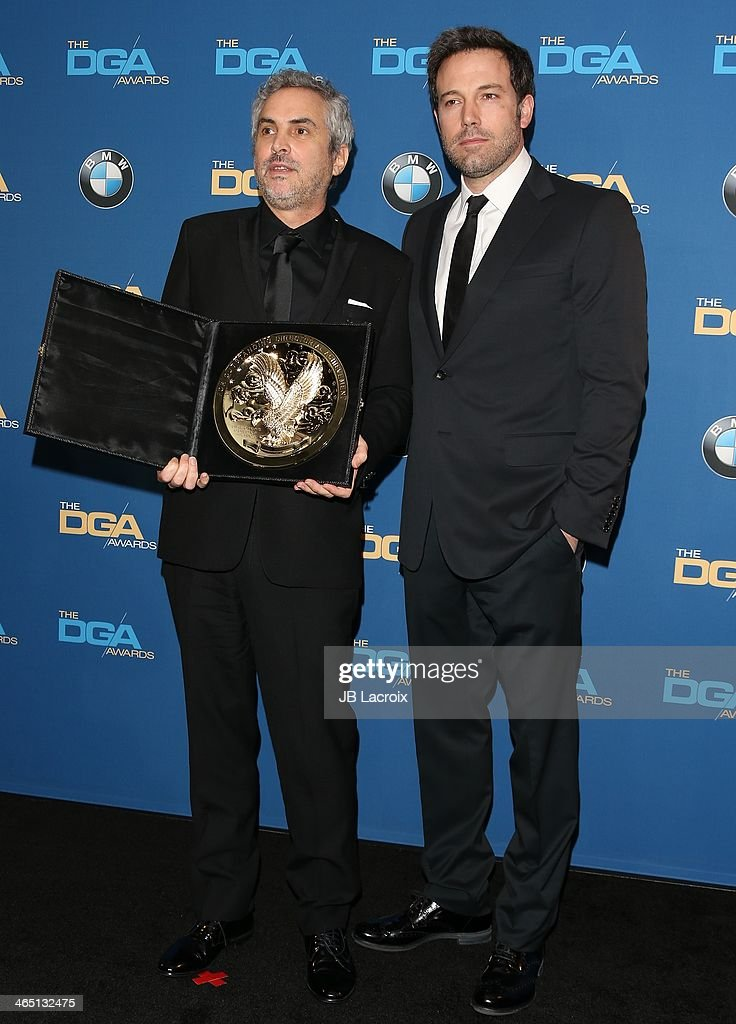 Alfonso Cuaron and Ben Affleck attend the 66th Annual Directors Guild Of America Awards - Press Room held at the Hyatt Regency Century Plaza on January 25, 2014 in Century City, California.