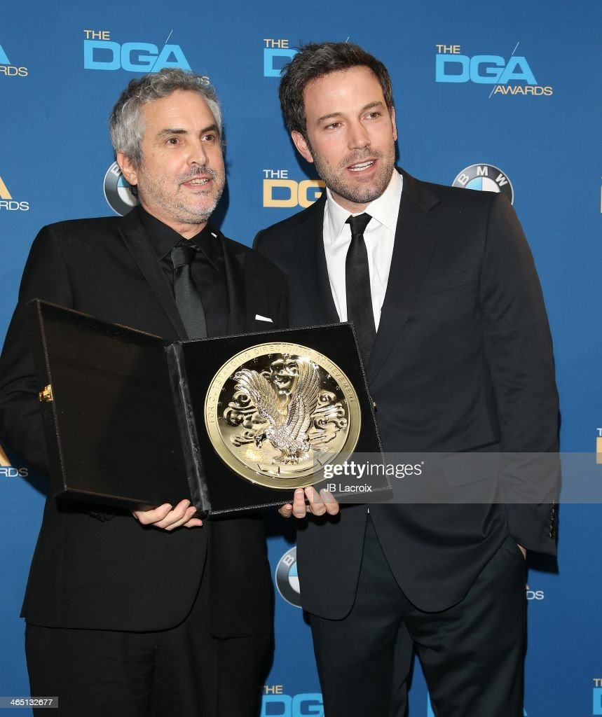 <a gi-track='captionPersonalityLinkClicked' href=/galleries/search?phrase=Alfonso+Cuaron&family=editorial&specificpeople=213792 ng-click='$event.stopPropagation()'>Alfonso Cuaron</a> and <a gi-track='captionPersonalityLinkClicked' href=/galleries/search?phrase=Ben+Affleck&family=editorial&specificpeople=201856 ng-click='$event.stopPropagation()'>Ben Affleck</a> attend the 66th Annual Directors Guild Of America Awards - Press Room held at the Hyatt Regency Century Plaza on January 25, 2014 in Century City, California.