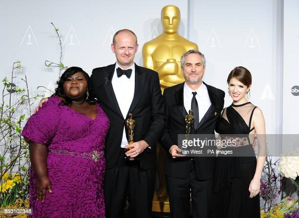 Alfonso Cuaron and Mark Sanger with the Film Editing award for 'Gravity' alongside Anna Kendrick and Gabourey Sidibe in the press room of the 86th...