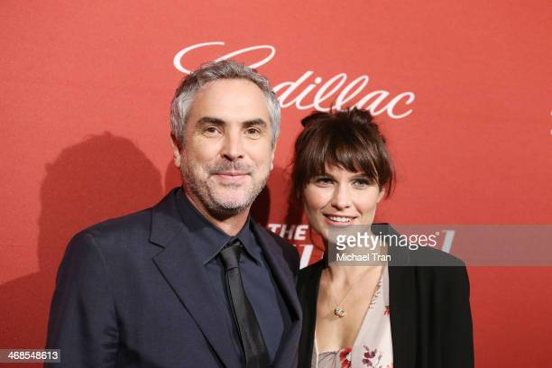 Alfonso Cuaron and Sheherazade Goldsmith arrive at The Hollywood Reporter's Annual Nominees Night party held at Spago on February 10 2014 in Beverly...