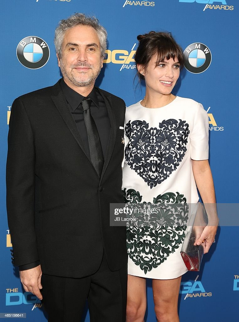 Alfonso Cuaron and Sheherazade Goldsmith attend the 66th Annual Directors Guild Of America Awards held at the Hyatt Regency Century Plaza on January 25, 2014 in Century City, California.