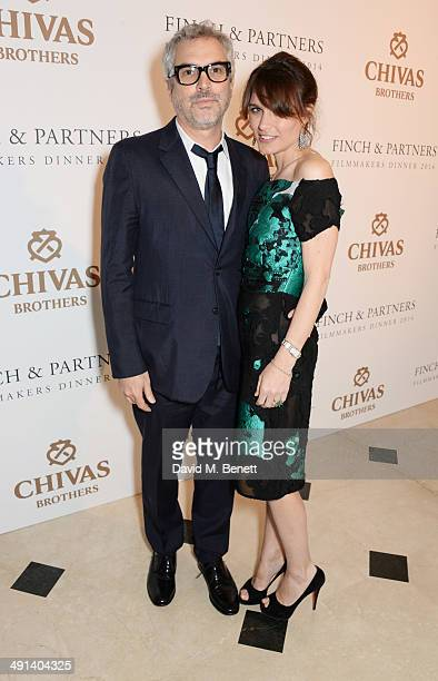 Alfonso Cuaron and Sheherazade Goldsmith attend the annual Charles Finch Filmmakers Dinner during the 67th Cannes Film Festival at Hotel du...