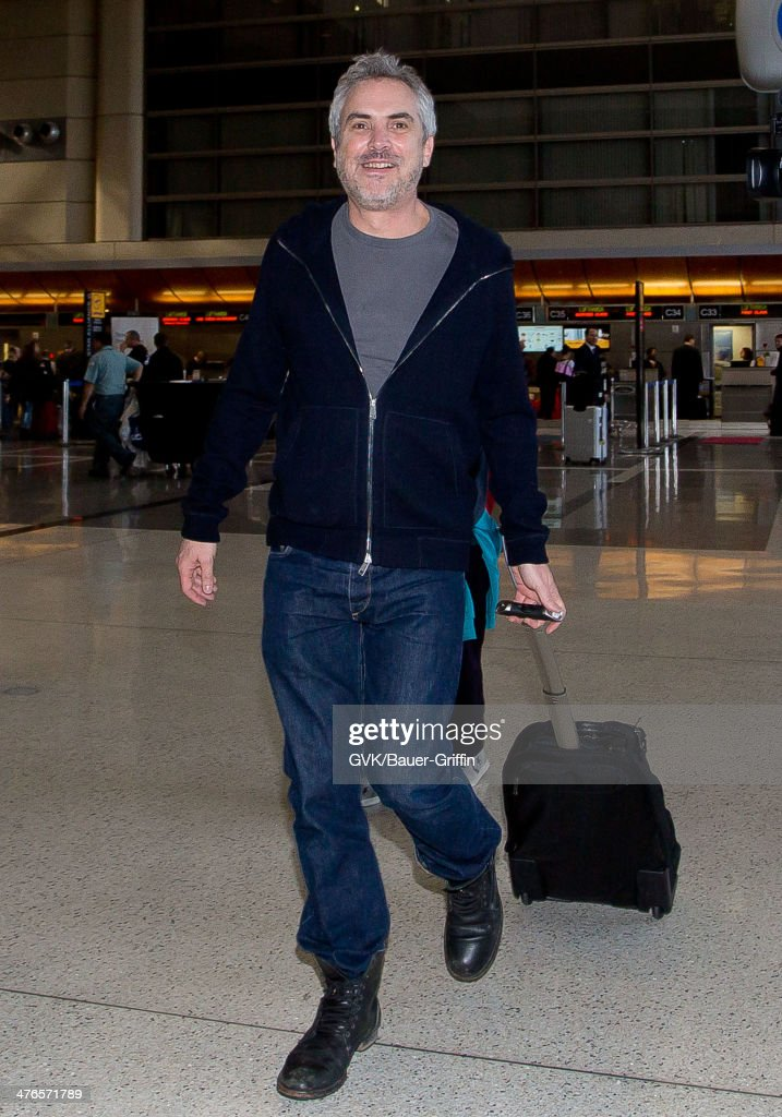 <a gi-track='captionPersonalityLinkClicked' href=/galleries/search?phrase=Alfonso+Cuaron&family=editorial&specificpeople=213792 ng-click='$event.stopPropagation()'>Alfonso Cuaron</a> is seen as he departs out of Los Angeles International Airport on March 03, 2014 in Los Angeles, California.