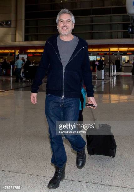 Alfonso Cuaron is seen as he departs out of Los Angeles International Airport on March 03 2014 in Los Angeles California