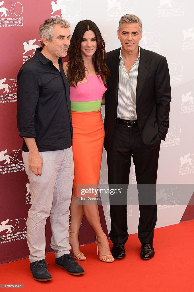 Alfonso Cuaron, Sandra Bullock and George Clooney attend the 'Gravity' photocall during the 70th Venice International Film Festival at the Palazzo del Casino on August 28, 2013 in Venice, Italy.