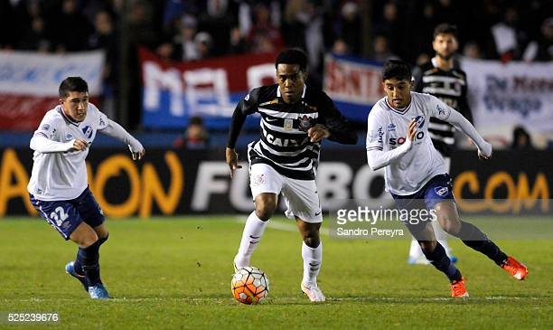 Alfonso Espino and Kevin Ramirez of Nacional fight for the ball with Elias of Corinthians during a match between Nacional and Corinthians as part of...