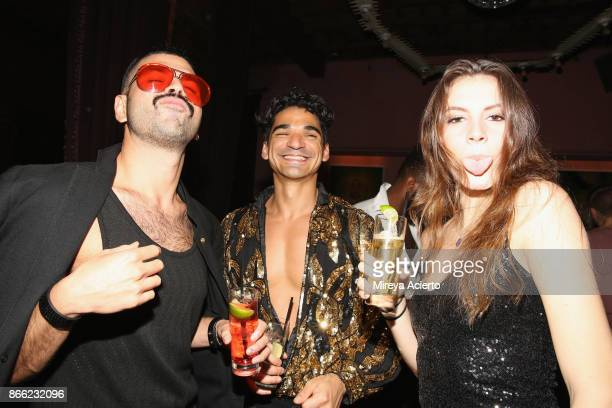 Alfonso Gaitan Ariel Rodriguez and Lauren Skowronski attend the Wilhelmina Halloween Disco Party at the Rose Bar at Gramercy Park Hotel on October 24...