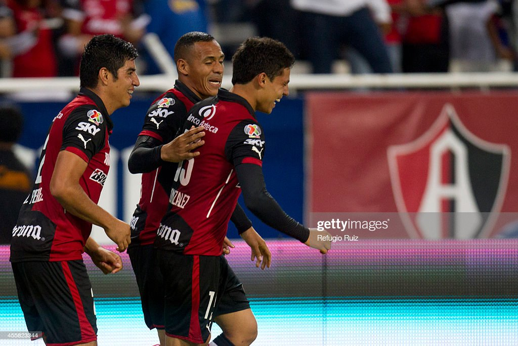 Alfonso Gonzalez of Atlas celebrates after scoring the first goal of the game during a match between Atlas and Cruz Azul as part of 9th round Apertura 2014 Liga MX at Jalisco Stadium on September 20, 2014 in Guadalajara, Mexico.