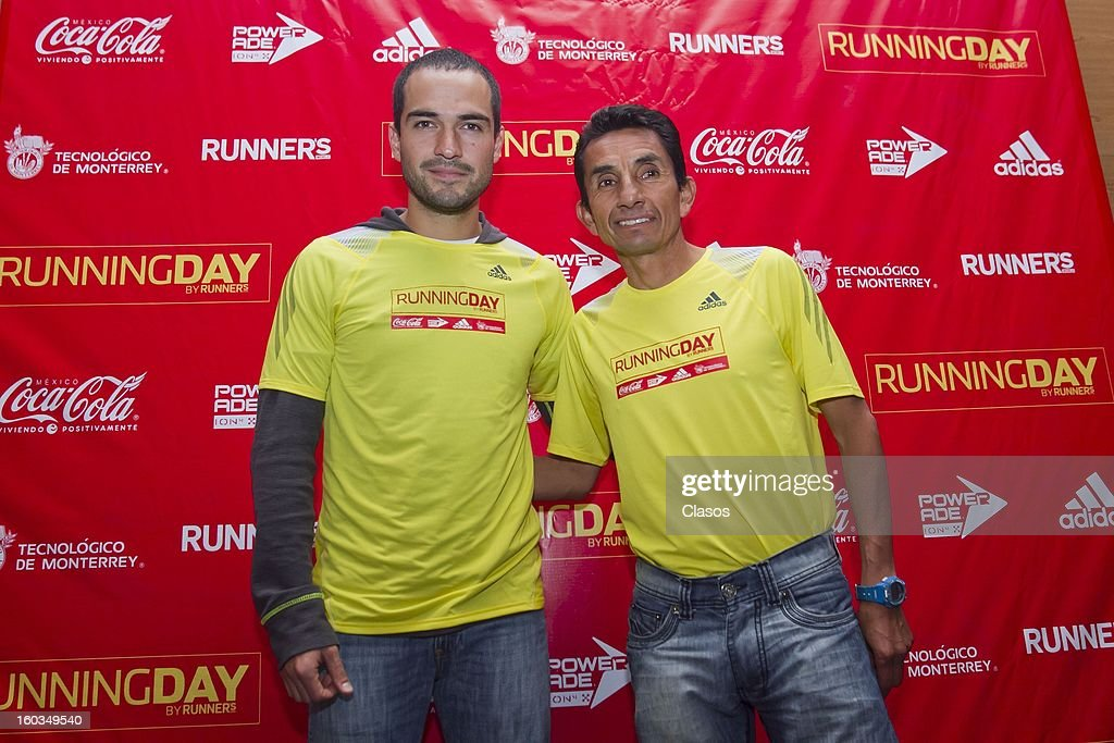 Alfonso Herrera and Benjamin Paredes pose during a press conference to announce the Running Day in Mexico on January 29, 2013 in Mexico City, Mexico.