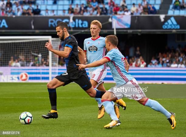 Alfonso Pedraza of Deportivo Alaves is challenged by Stanislav Lobotka of Celta de Vigo during the La Liga match between Celta de Vigo and Deportivo...