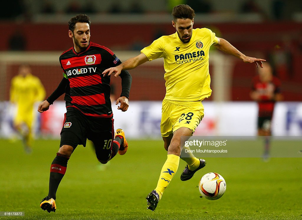 Alfonso Pedraza of Villarreal and Hakan Calhanoglu of Bayer Leverkusen battle for the ball during the UEFA Europa League round of 16, second leg match between Bayer Leverkusen and Villarreal CF at Bay Arena on March 17, 2016 in Leverkusen, Germany.