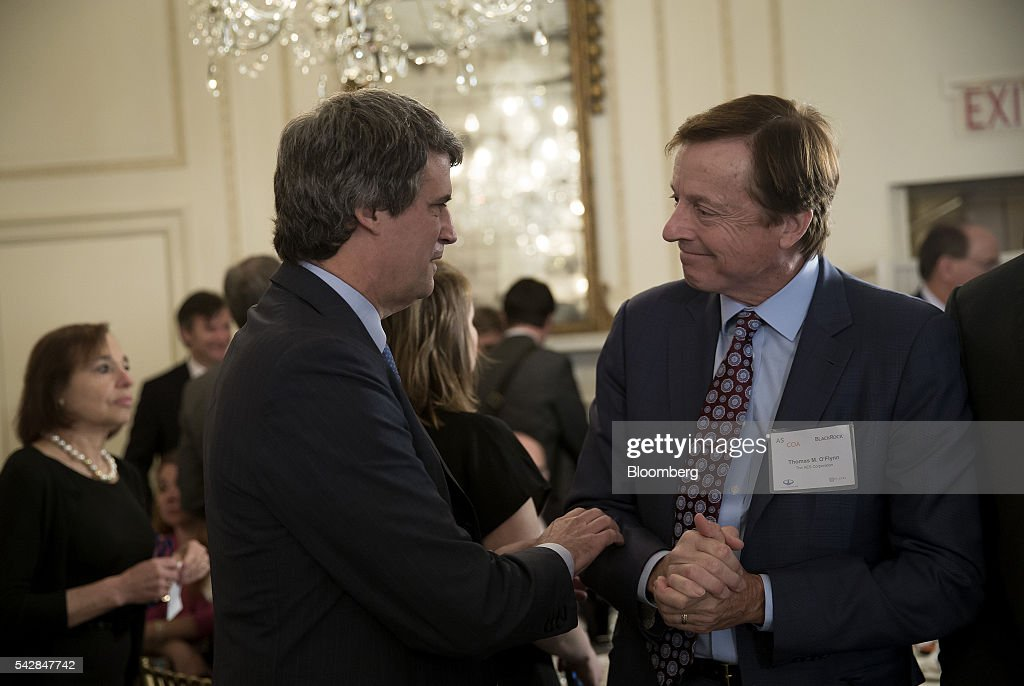 Alfonso Prat-Gay, finance minister of Argentina, left, greets Thomas 'Tom' O'Flynn, executive vice president and chief financial officer of AES Corp., during the Argentina Investment Conference in New York, U.S., on Friday, June 24, 2016. The Argentina Investment Conference 2016 brought together senior policy makers, investors, and international and national business leaders for an insightful discussion on foreign investment in Argentina. Photographer: Eric Thayer/Bloomberg via Getty Images