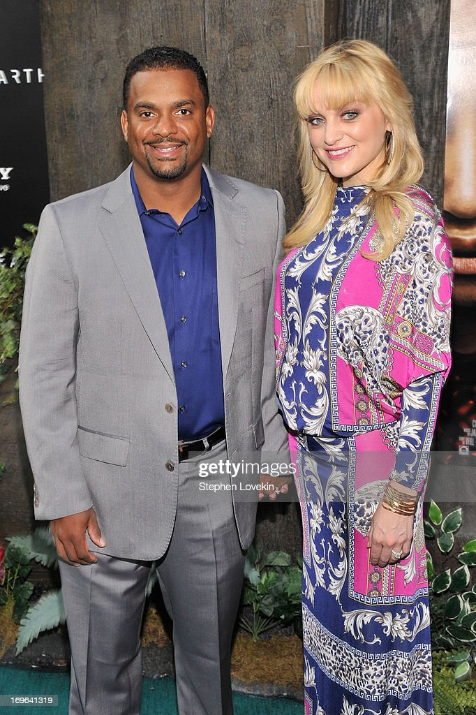Alfonso Ribeiro and Angela Unkrich attend the 'After Earth' premiere at Ziegfeld Theater on May 29, 2013 in New York City.