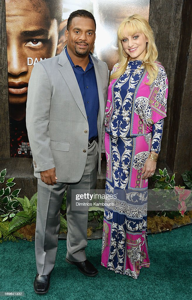 <a gi-track='captionPersonalityLinkClicked' href=/galleries/search?phrase=Alfonso+Ribeiro&family=editorial&specificpeople=628950 ng-click='$event.stopPropagation()'>Alfonso Ribeiro</a> and Angela Unkrich attend the 'After Earth' premiere at Ziegfeld Theater on May 29, 2013 in New York City.