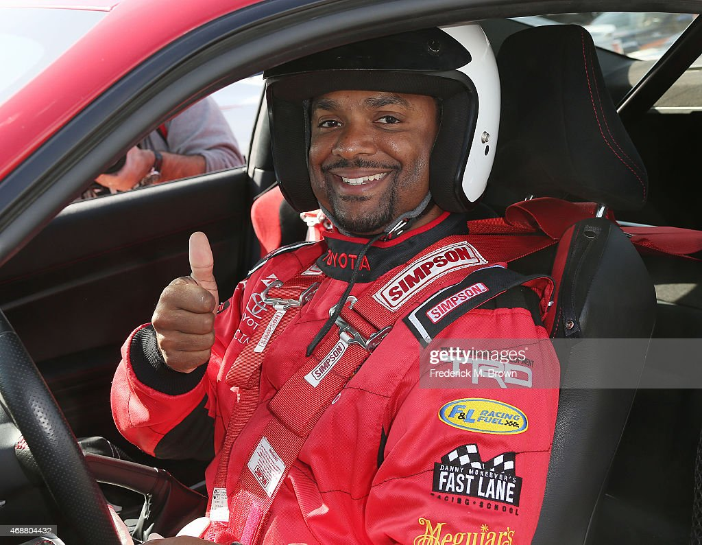 <a gi-track='captionPersonalityLinkClicked' href=/galleries/search?phrase=Alfonso+Ribeiro&family=editorial&specificpeople=628950 ng-click='$event.stopPropagation()'>Alfonso Ribeiro</a> gives a thumbs up to photographers during the 38th Annual Toyota Pro/Celebrity Race Press Day at the Toyota Grand Prix of Long Beach on April 7, 2015 in Long Beach, California.