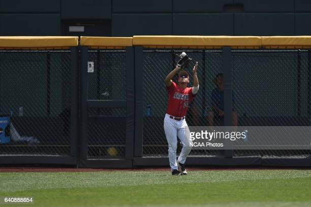 Alfonso Rivas of the University of Arizona catches a fly ball for an out against Coastal Carolina University during Game 3 of the Division I Men's...
