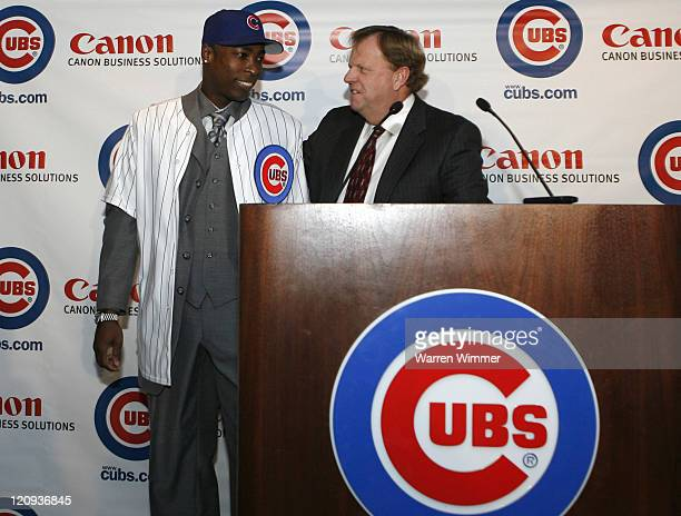Alfonso Soriano and Cubs General Manager Jim Hendry after Hendry introduced Soriano to the Chicago media at the Stadium Club Wrigley Field in Chicago...