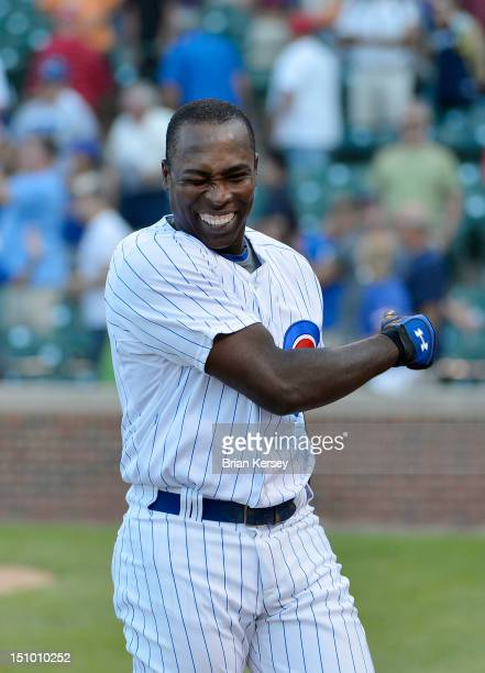 Alfonso Soriano of the Chicago Cubs celebrates after hitting a gamewinning RBI single scoring Starlin Castro during the ninth inning against the...