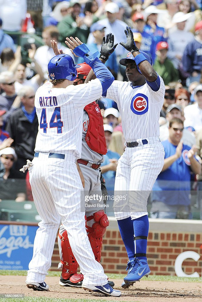 Alfonso Soriano #12 of the Chicago Cubs hits a is greeted by Anthony Rizzo #44 after hitting his second two- run homer of the day against the Cincinnati Reds during the third inning on May 4, 2013 at Wrigley Field in Chicago, Illinois.