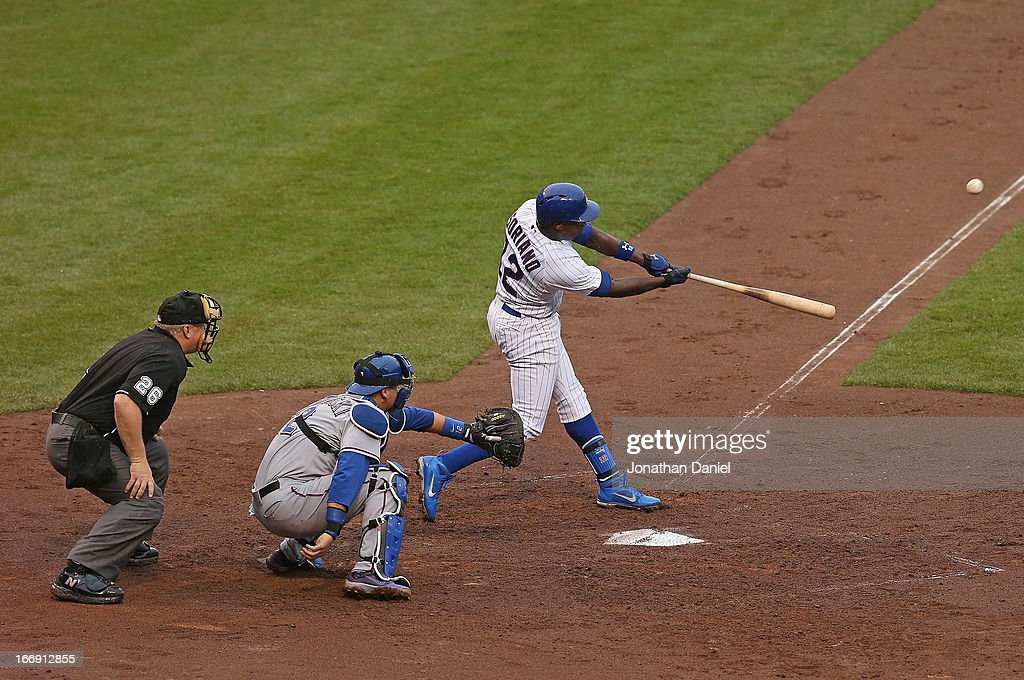 <a gi-track='captionPersonalityLinkClicked' href=/galleries/search?phrase=Alfonso+Soriano&family=editorial&specificpeople=202251 ng-click='$event.stopPropagation()'>Alfonso Soriano</a> #12 of the Chicago Cubs hits a solo home run in the 3rd inning against the Texas Rangers at Wrigley Field on April 18, 2013 in Chicago, Illinois.