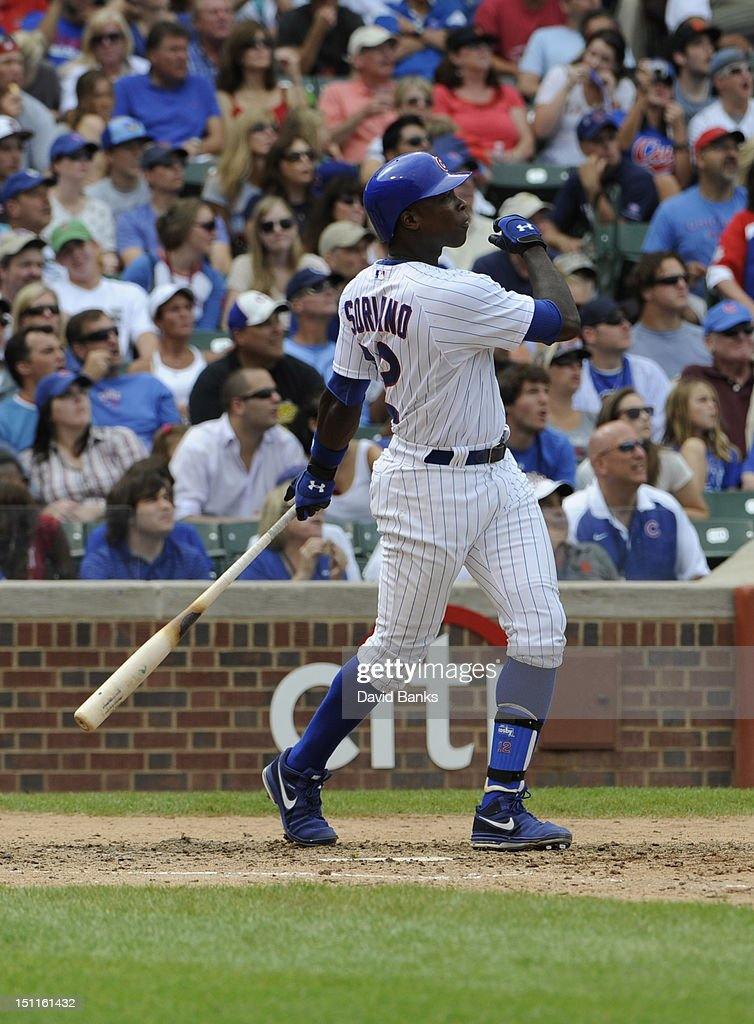 <a gi-track='captionPersonalityLinkClicked' href=/galleries/search?phrase=Alfonso+Soriano&family=editorial&specificpeople=202251 ng-click='$event.stopPropagation()'>Alfonso Soriano</a> #12 of the Chicago Cubs hits a three run homer in the fifth inning against the San Francisco Giants on September 02 2012 at Wrigley Field in Chicago, Illinois.
