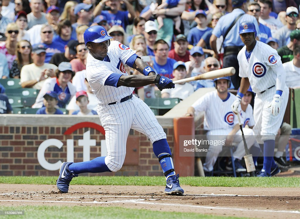 <a gi-track='captionPersonalityLinkClicked' href=/galleries/search?phrase=Alfonso+Soriano&family=editorial&specificpeople=202251 ng-click='$event.stopPropagation()'>Alfonso Soriano</a> #12 of the Chicago Cubs hits an RBI single against the Pittsburgh Pirates in the first inning, giving him 100 RBI's for the season on September 16, 2012 at Wrigley Field in Chicago, Illinois.