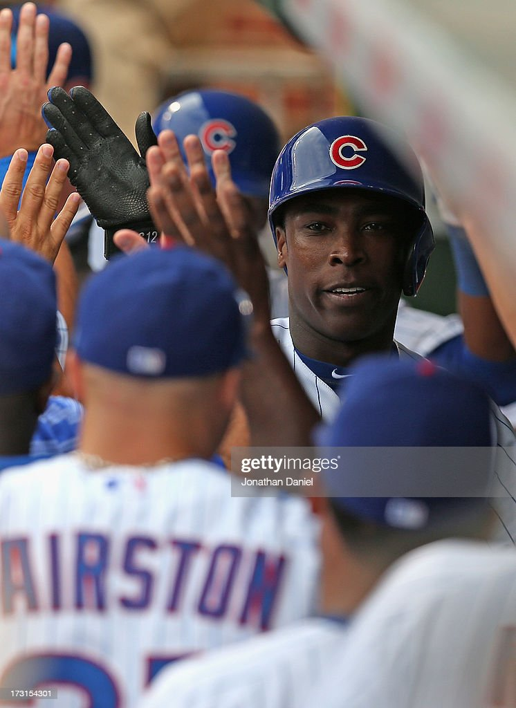 <a gi-track='captionPersonalityLinkClicked' href=/galleries/search?phrase=Alfonso+Soriano&family=editorial&specificpeople=202251 ng-click='$event.stopPropagation()'>Alfonso Soriano</a> #12 of the Chicago Cubs is congratulated in the dugout after hitting his second two-run home run of the game in the 5th inning against the Pittsburgh Pirates at Wrigley Field on July 6, 2013 in Chicago, Illinois. The Cubs defeated the pirates 4-1.