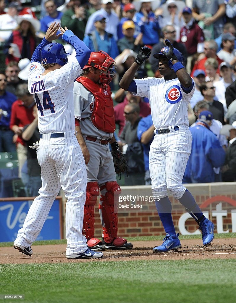 Alfonso Soriano #12 of the Chicago Cubs is greeted by Anthony Rizzo #44 after hitting a two-run homer during the first inning against the Cincinnati Reds on May 4, 2013 at Wrigley Field in Chicago, Illinois.