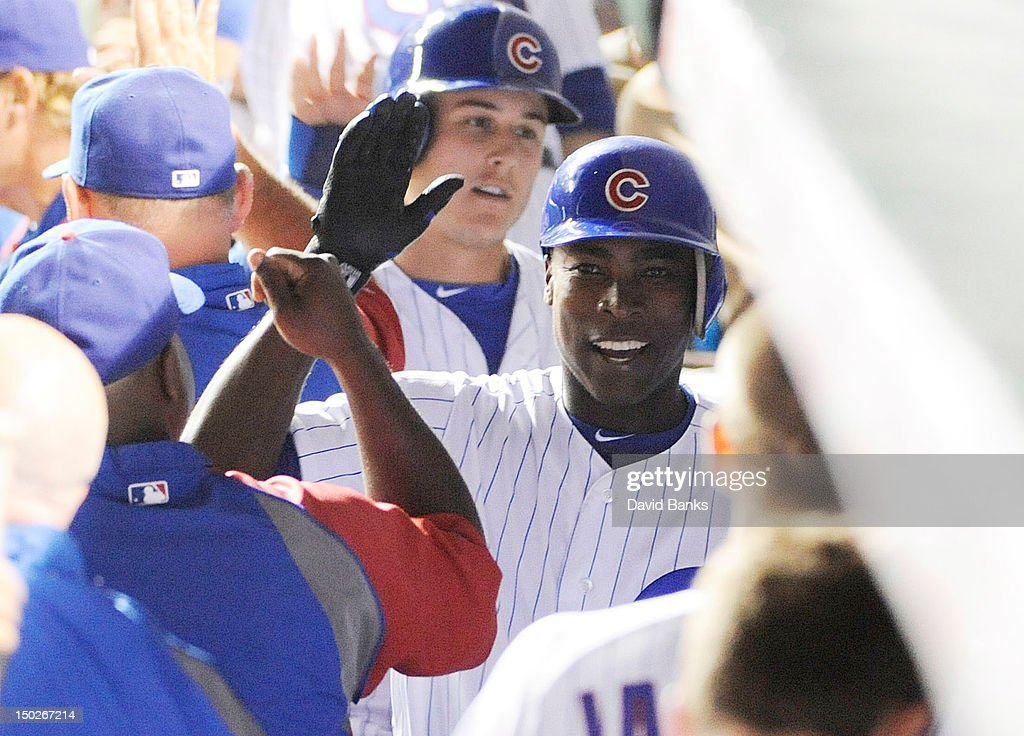 Alfonso Soriano #12 of the Chicago Cubs is greeted by his teammates after hitting a two run homer against the Houston Astros in the fifth inning on August 13, 2012 at Wrigley Field in Chicago, Illinois.