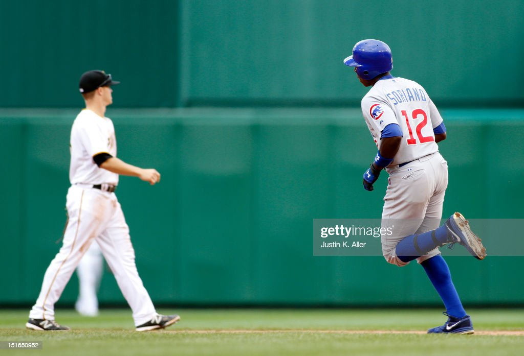 <a gi-track='captionPersonalityLinkClicked' href=/galleries/search?phrase=Alfonso+Soriano&family=editorial&specificpeople=202251 ng-click='$event.stopPropagation()'>Alfonso Soriano</a> #12 of the Chicago Cubs rounds second after hitting a two run home run in the eighth inning against the Pittsburgh Pirates during the game on September 9, 2012 at PNC Park in Pittsburgh, Pennsylvania.