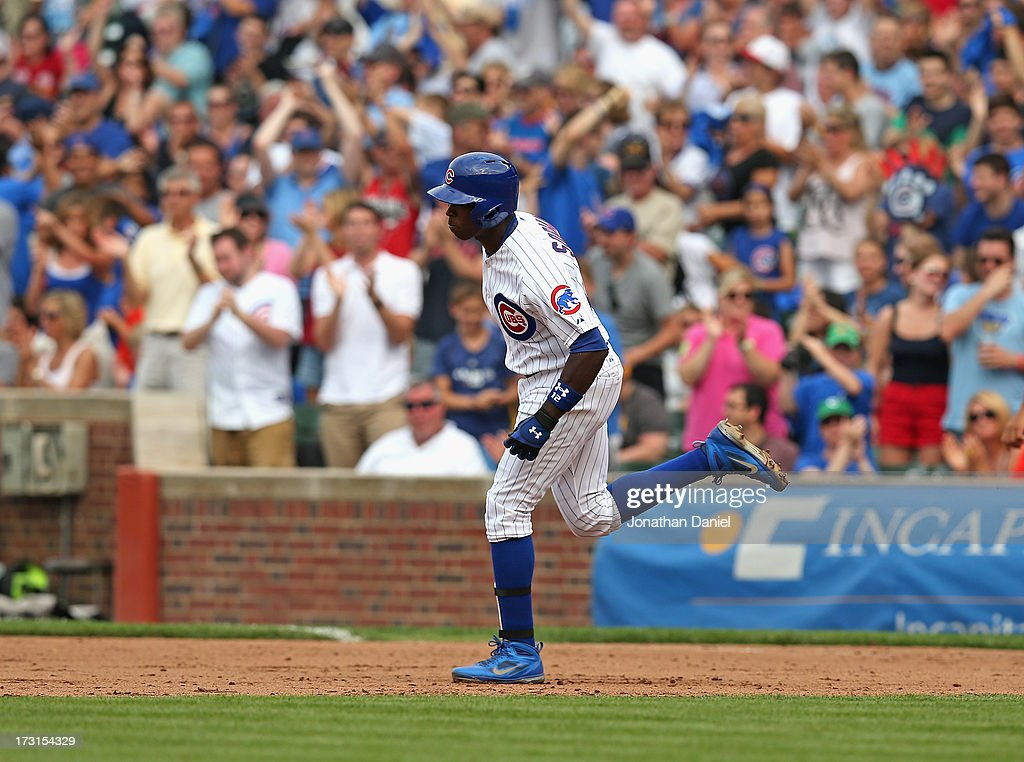 <a gi-track='captionPersonalityLinkClicked' href=/galleries/search?phrase=Alfonso+Soriano&family=editorial&specificpeople=202251 ng-click='$event.stopPropagation()'>Alfonso Soriano</a> #12 of the Chicago Cubs runs the bases after hitting his second two-run home run of the game in the 5th inning against the Pittsburgh Pirates at Wrigley Field on July 6, 2013 in Chicago, Illinois. The Cubs defeated the pirates 4-1.