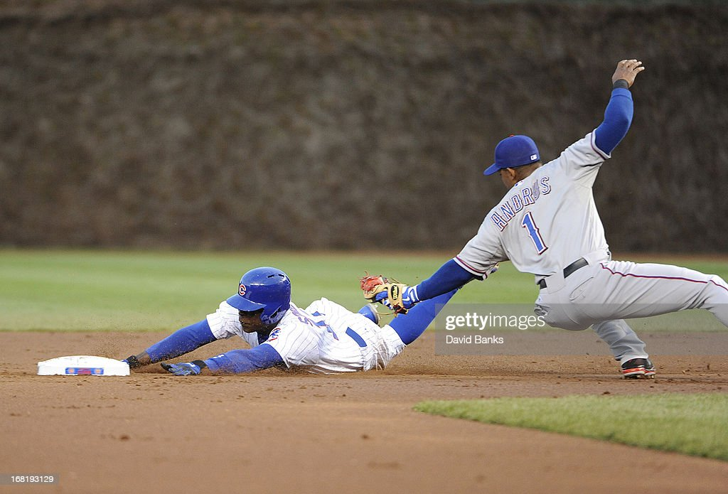 <a gi-track='captionPersonalityLinkClicked' href=/galleries/search?phrase=Alfonso+Soriano&family=editorial&specificpeople=202251 ng-click='$event.stopPropagation()'>Alfonso Soriano</a> #12 of the Chicago Cubs steals second base as <a gi-track='captionPersonalityLinkClicked' href=/galleries/search?phrase=Elvis+Andrus&family=editorial&specificpeople=4845974 ng-click='$event.stopPropagation()'>Elvis Andrus</a> #1 of the Texas Rangers tags him during the first inning on May 6, 2013 at Wrigley Field in Chicago, Illinois.